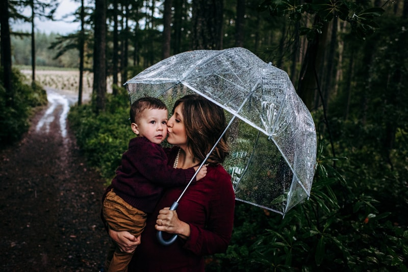 Family Photography, Mother kissing son in the rain