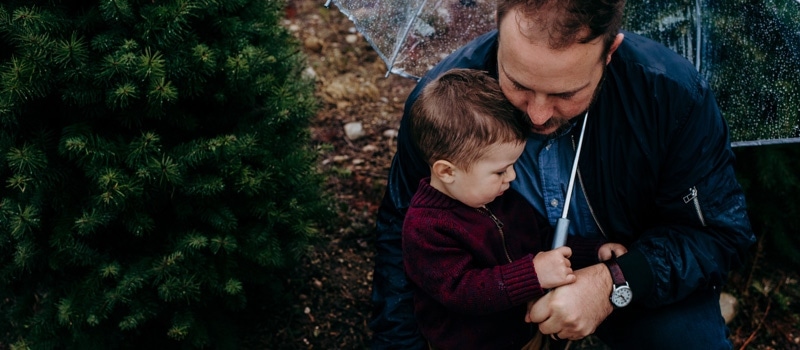 Family Photography, father and son on a rainy day