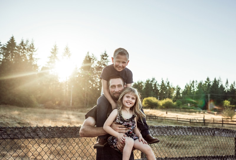 Family Photographer | Family Photography Memories | dad and kids against a fence