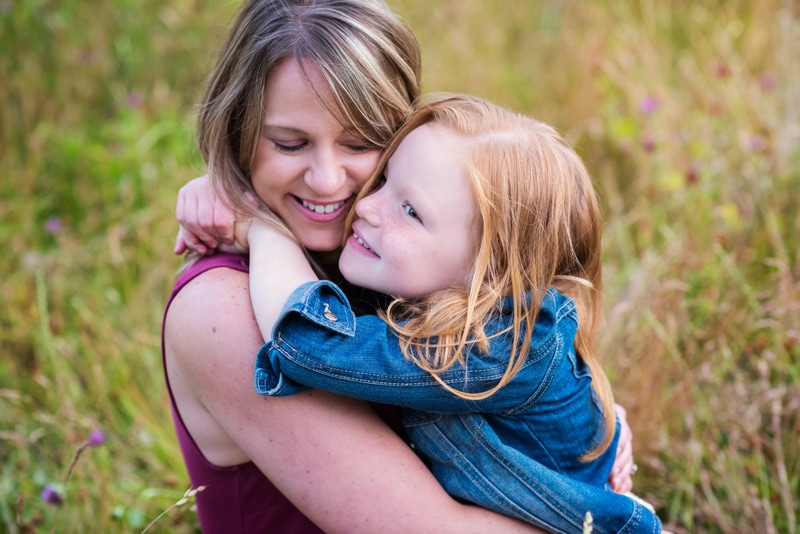 Family Photography, daughter hugging mom around the neck