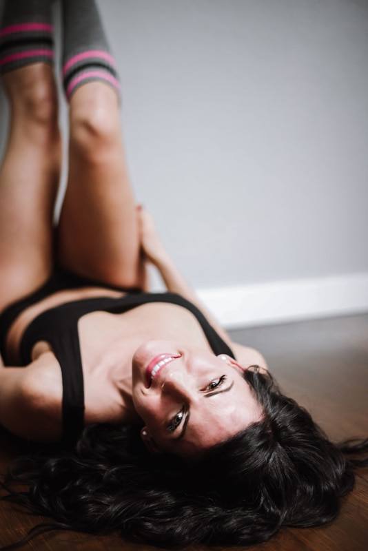Boudoir Photography - Boudoir Photographer - Woman on the floor with legs up the wall