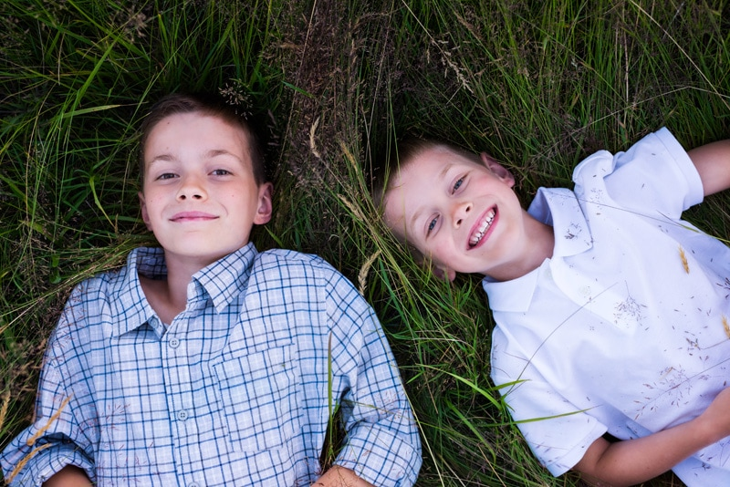 Children Photography - Children Photographer - Boys laying in the grass