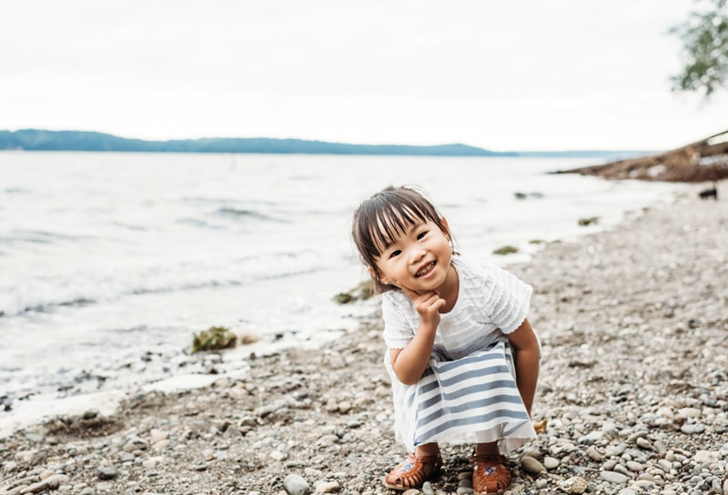 Family Photographer, Family Photography Memories, Little girl squatting down next to the water