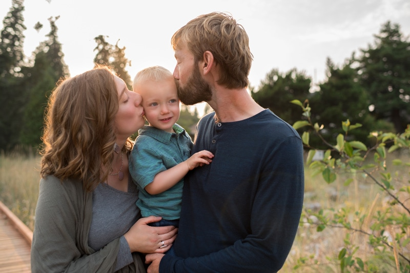 Family Photography, mother and father both kissing boy