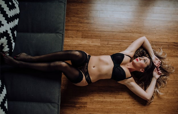 Boudoir Photography | Classy Boudoir Photography! | Woman laying on floor with feet up on couch